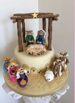 christmas cake showing nativity theme on the top