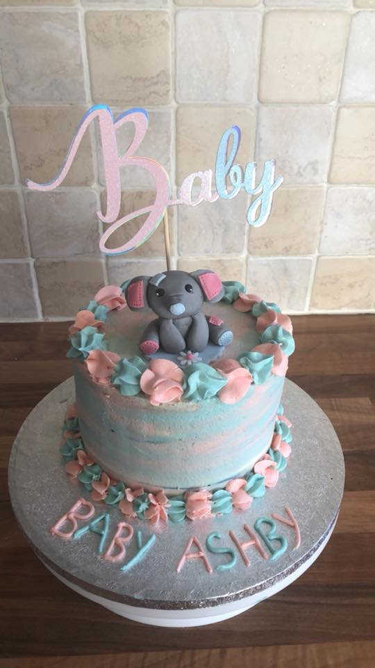 Ombre gender reveal cake with baby elephant