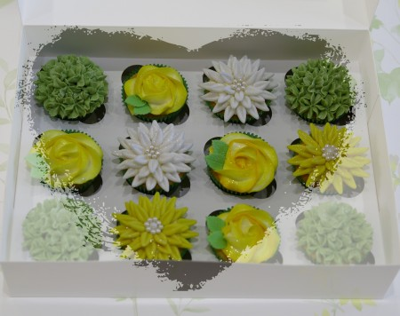 Spring coloured buttercream topped cupcakes