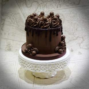 chocolate drip cake with chocolate decoration