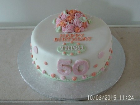 2 tier vanilla sponge with iced top + 'happy 90th birthday'