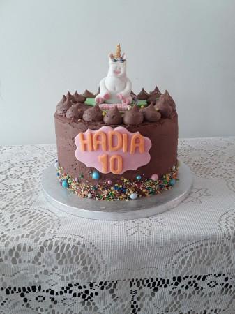 Chocolate rainbow cake with edible unicorn