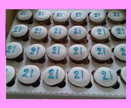 Chocolate cupcakes, iced & handwritten initialing