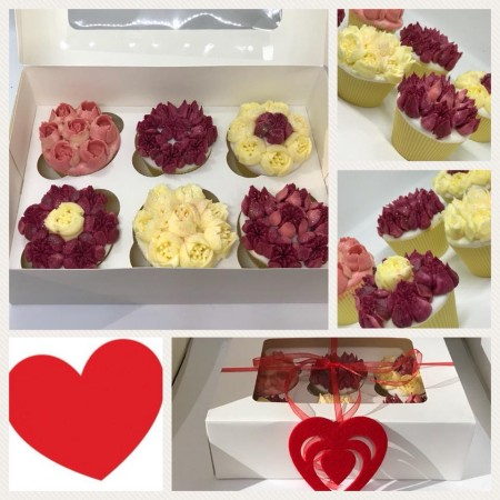Box of floral Cupcakes
