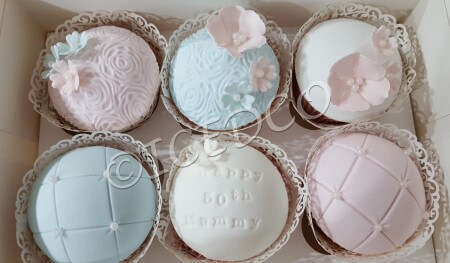 A Box of pastel Cupcakes