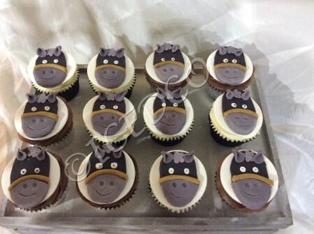 Box of Decorated animal Cupcakes