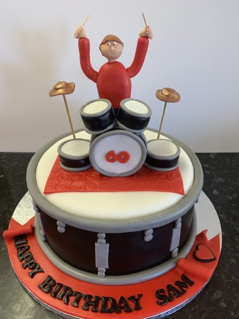 Lemon Drum cake with dummer and arms in air