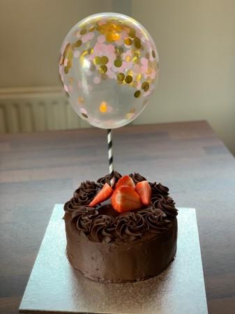Confetti balloon topper chocolate cake