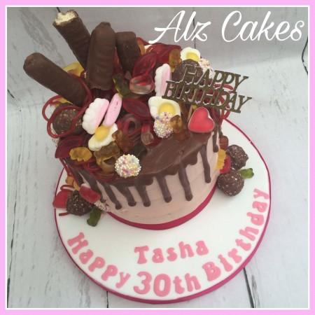 """7"""" Sweets Overload Dark Chocolate Drip Cake."""