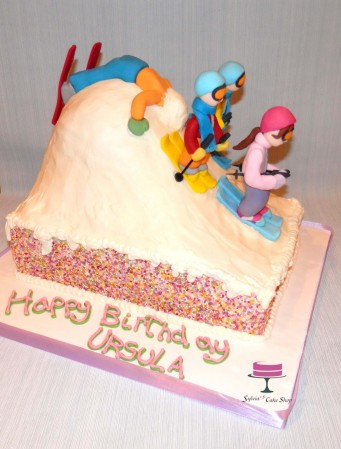 4 skiers on top of cake as email described