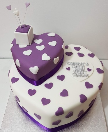 "12"" heart shaped cake, with a smaller heart on top ( purple /white/ silver colors)"