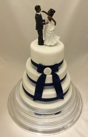 3 tier wedding cake with bride and groom
