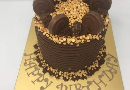 Chocolate Layered cake with gold decorations