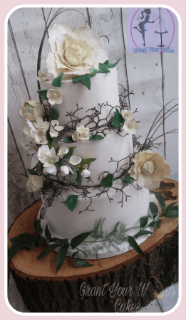 3 Tier Wedding Cake adorned with handmade flowers. Can be baked Gluten / Dairy free.