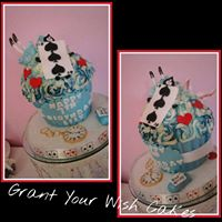 Alice in wonderland theme Giant Cupcake. Cake can be baked Gluten / Dairy free.