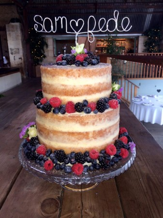 2 tier naked cake with seasonal berries