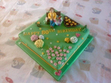 Bespoke- Chocolate cake-  lady on bench in garden, sewing patchwork and birds