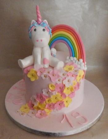 Bespoke Rainbow cake with plain cream frosting + Sprinkles