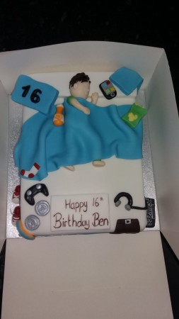 Boy in a Bed Cake