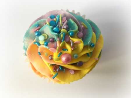Bespoke Rainbow Swirl Buttercream with letters on each Cupcakes