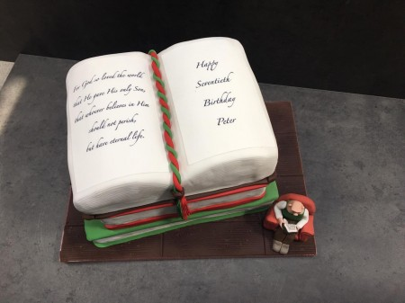 3 book cake with wallace reading alongside
