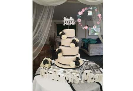 4 tier Ivory and Black Wedding cake