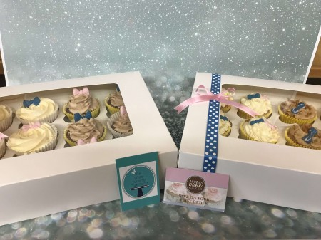 24 baby shower cupcakes- Pink and blue Bows