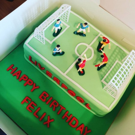 Football field cake with figurines