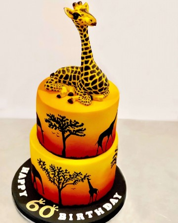 8 inch and 6 inch Fondant two tier vanilla cake Air brushed and painted on black iced board with ribbon + Giraffe topper