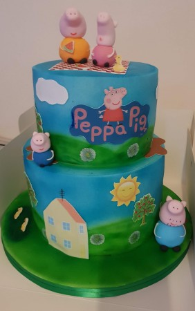 Peppa pig and george pig playing ball cake