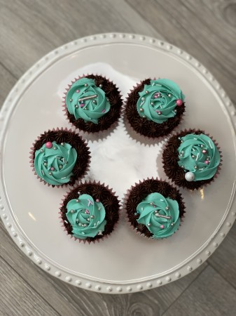 Chocolate cupcakes with a rose and mint frosting