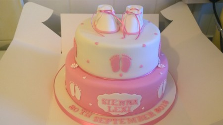 2 tier pink and white cake