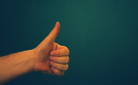 thumbs up sign from a  hand