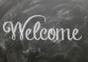 Welcome written on chalk board