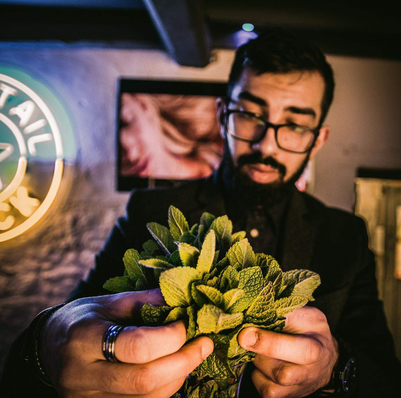 Barman with fresh mint