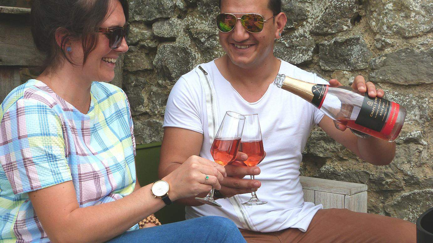 Happy customers drinking Chapel Down rose