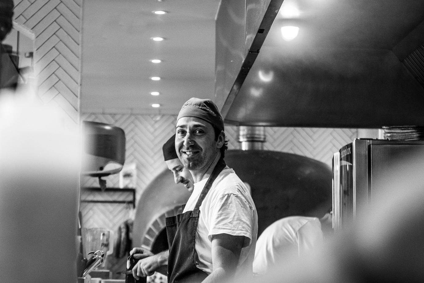 Chef with pizza oven