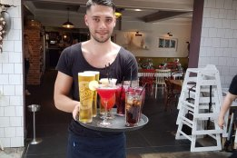 Barman serving drinks