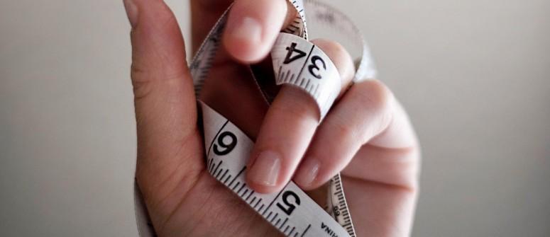 tape-measure-on-hand